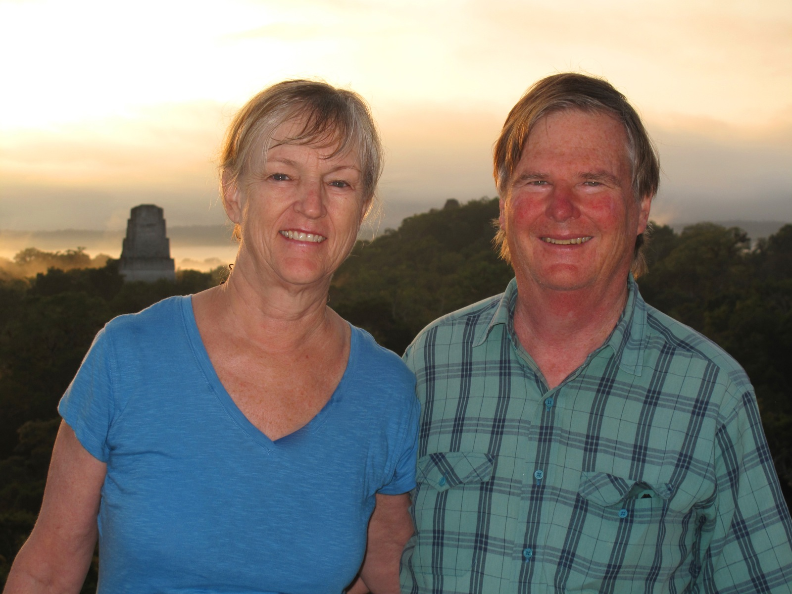 Two participants pose at sunset in Tikal.