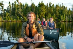 Staff and participants enjoy a calm canoe along the shore of the lake