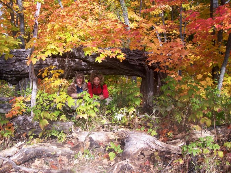 Two participants hide under the changing leaves of the Superior Hiking Trail.