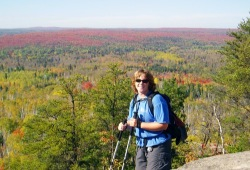 Beth takes in the fall colors on the Superior Hiking Trail.