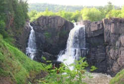 Two waterfalls cut through rock at Pigeon Falls on the Superior Hiking Trail.