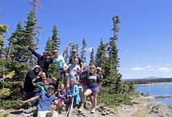 Group of people strike a pose for the camera near Yellowstone Lake.