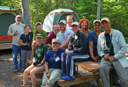 Participants gather at a picnic table at Wilderness Inquiry's Apostles Islands kayaking base camp.