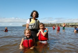 Woman with two girls at Little Sand Bay during an Apostle Island vacation for families.