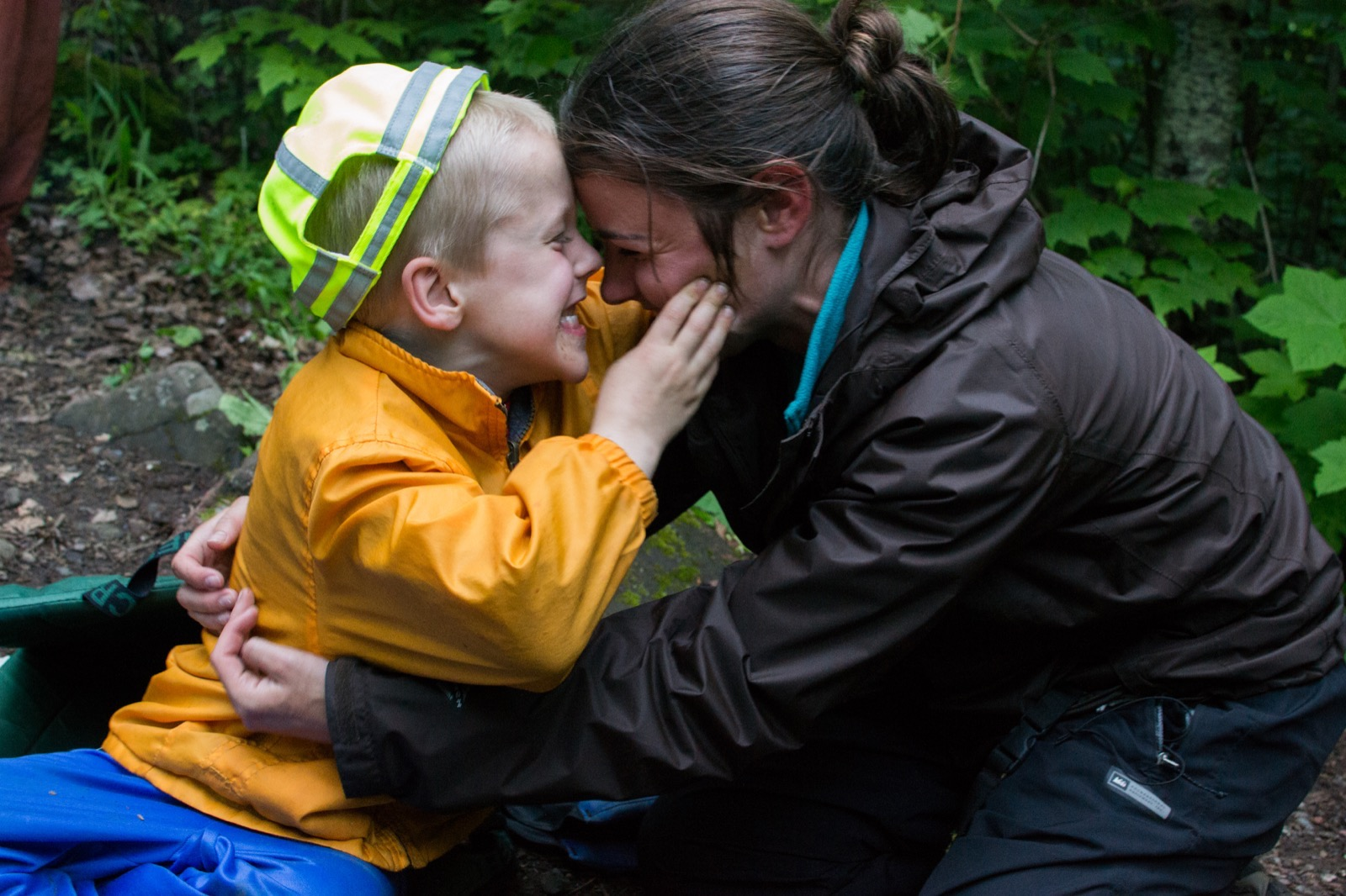 WI guide Adreon Morgan embraces a young participant on a Boundary Waters family trip.
