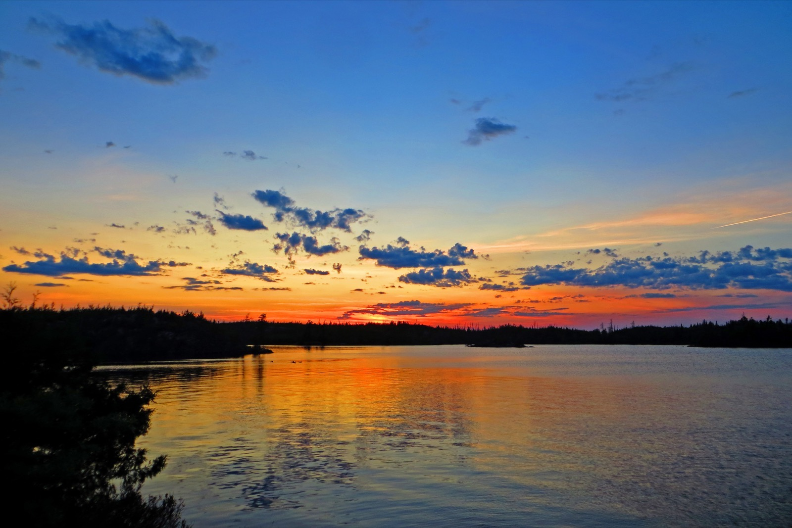 A red sunset fades to blue sky in the Boundary Waters.