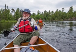 A man paddles the Boundary Waters in a canoe