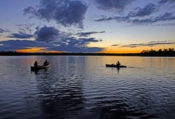 A canoe and kayak in White Iron Lake at sunset.