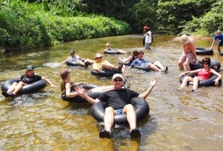 A peaceful float in inner tubes along a shallow stream in Belize