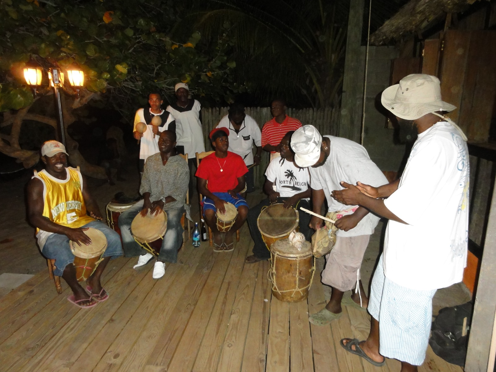 Garifuna people form a drum circle.