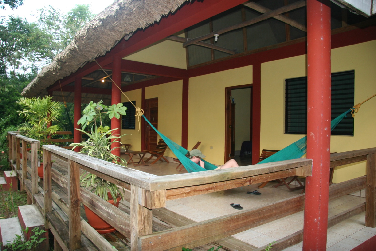 A participant lounges in a blue hammock on the porch of the San Ignacio resort.