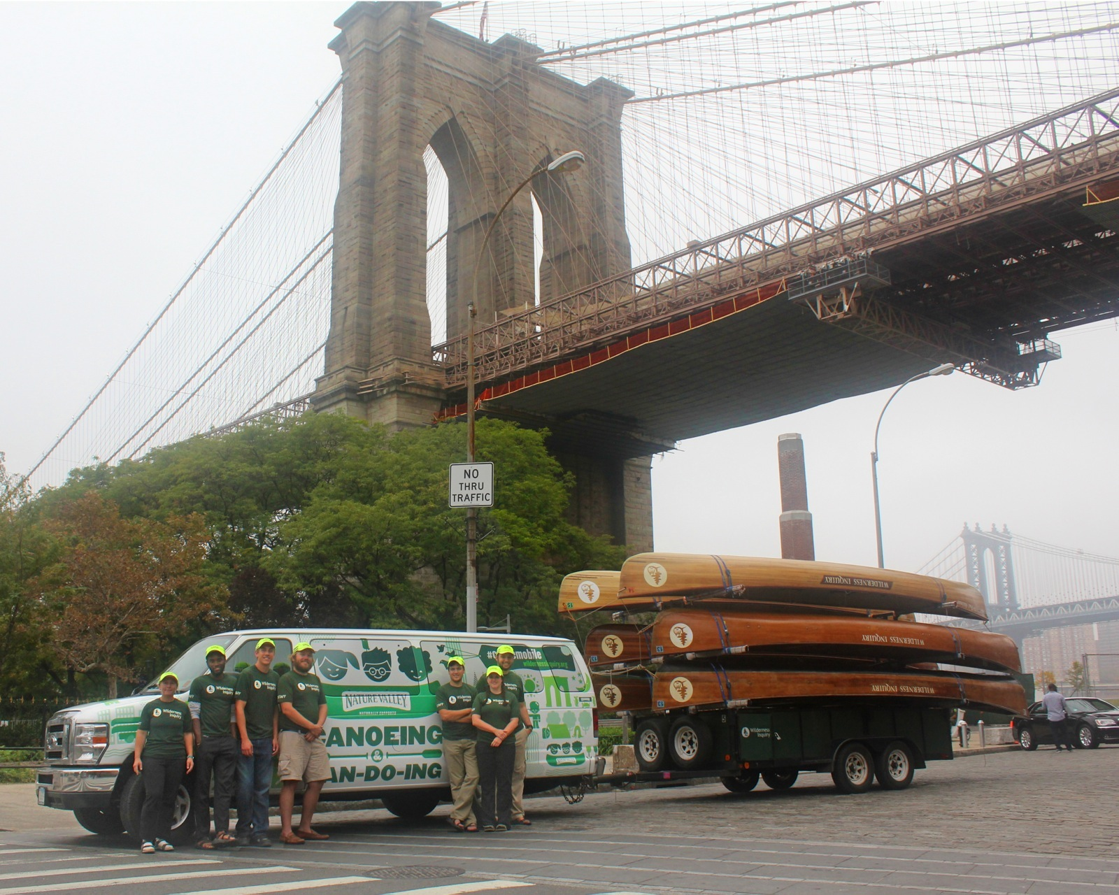 group photo of crew members in front of canoemobile van and canoes by Octavio Molina