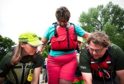 two staff help participants into the voyageur canoe in Minnesota