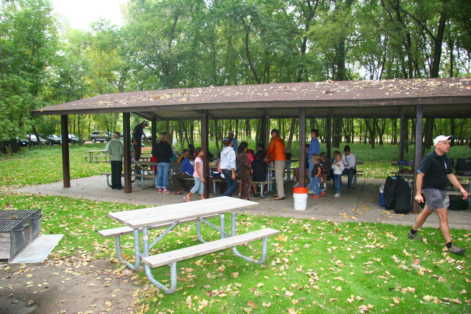 Participants gather under the pavilion at Fort Snelling to make lunch.