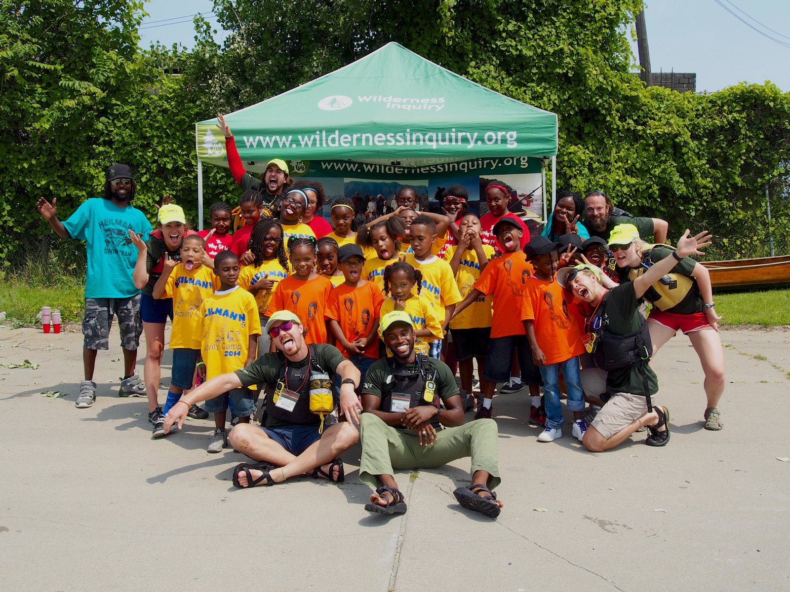 group photo of students and staff on the beach after canoeing the Detroit River
