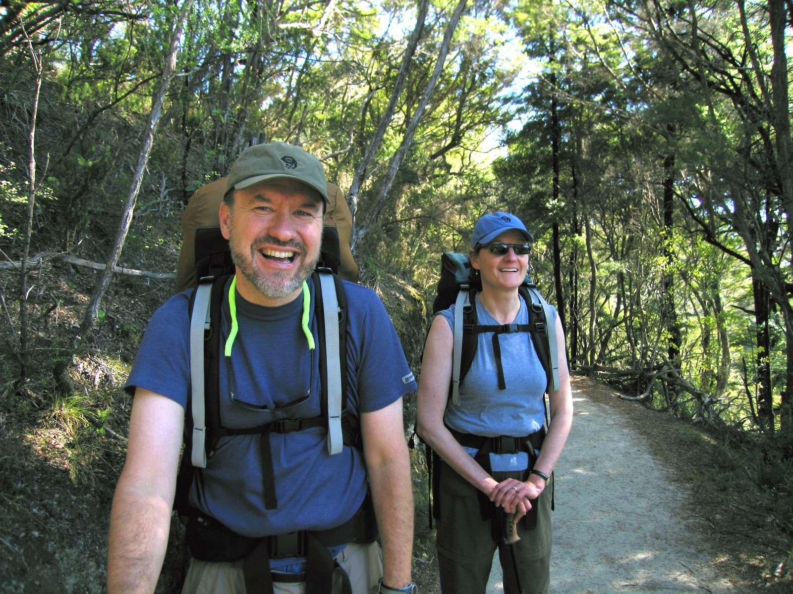 Two participants smile while hiking the Minong Ridge on Isle Royale National Park.