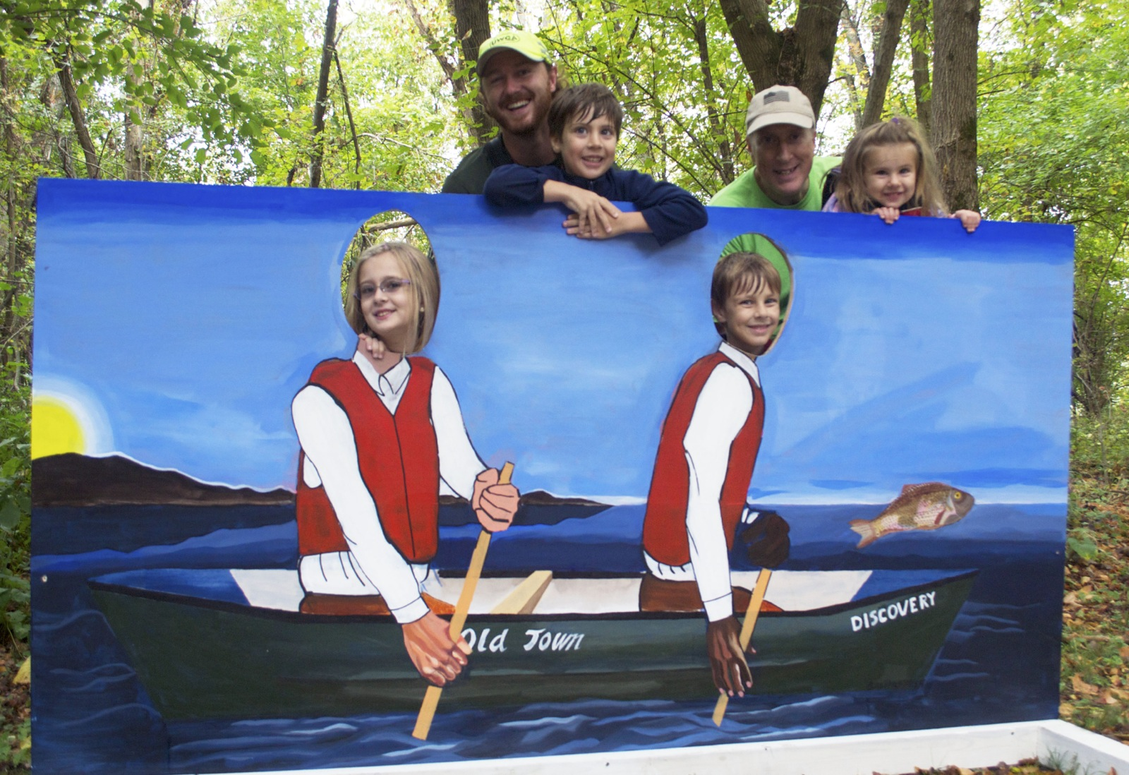 A family pose for a photo in a stand in photo cut out  in Louisville
