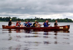 a group of 10 canoe  along the river on a cloudy day in Mankato