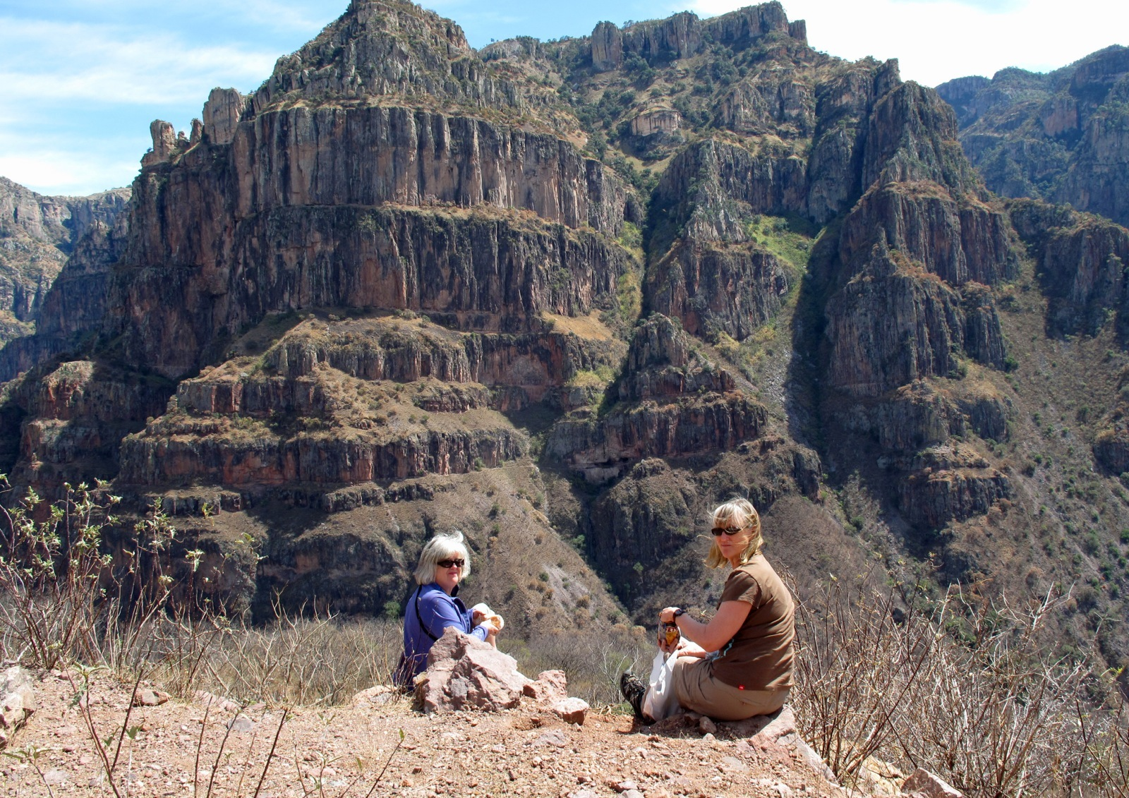 Two women enjoying the view of a spectacular geological formation called Wedding Cake Mountain in Copper Canyon.