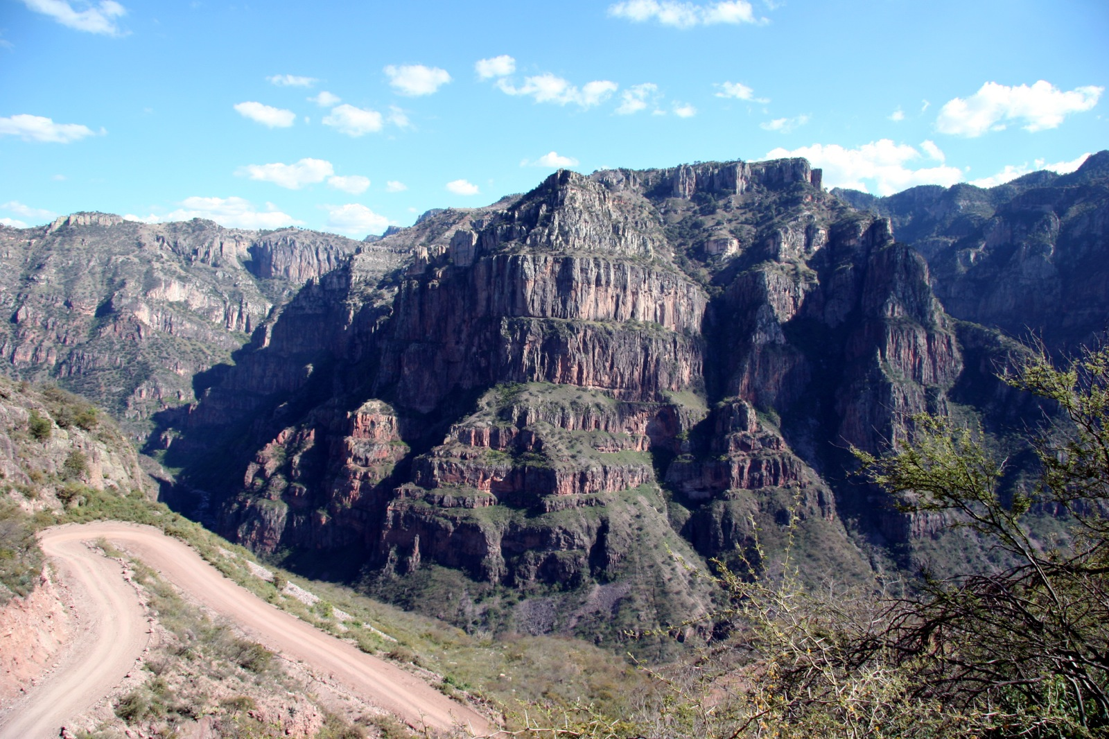 A view of Wedding Cake Mountain and the switchback roads during Mexico's Copper Canyon Trek.