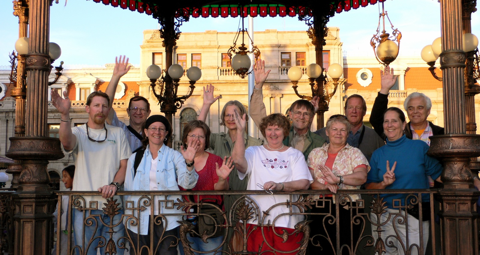 The Wilderness Inquiry group waves from an ornate pavilion in the plaza of Chihuahua Mexico.