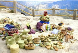Tarahumara women sells hand-woven baskets and trinkets at an overlook at Divisadero Copper Canyon.