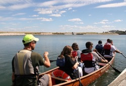 participants and staff paddle away from the dock into the river   in Milwaukee