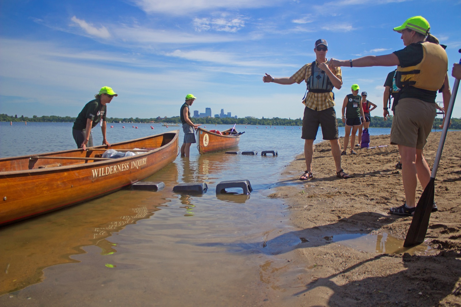 Wilderness Inquiry staff prepare two canoes on the beach for a fun day on the Chain of Lakes.