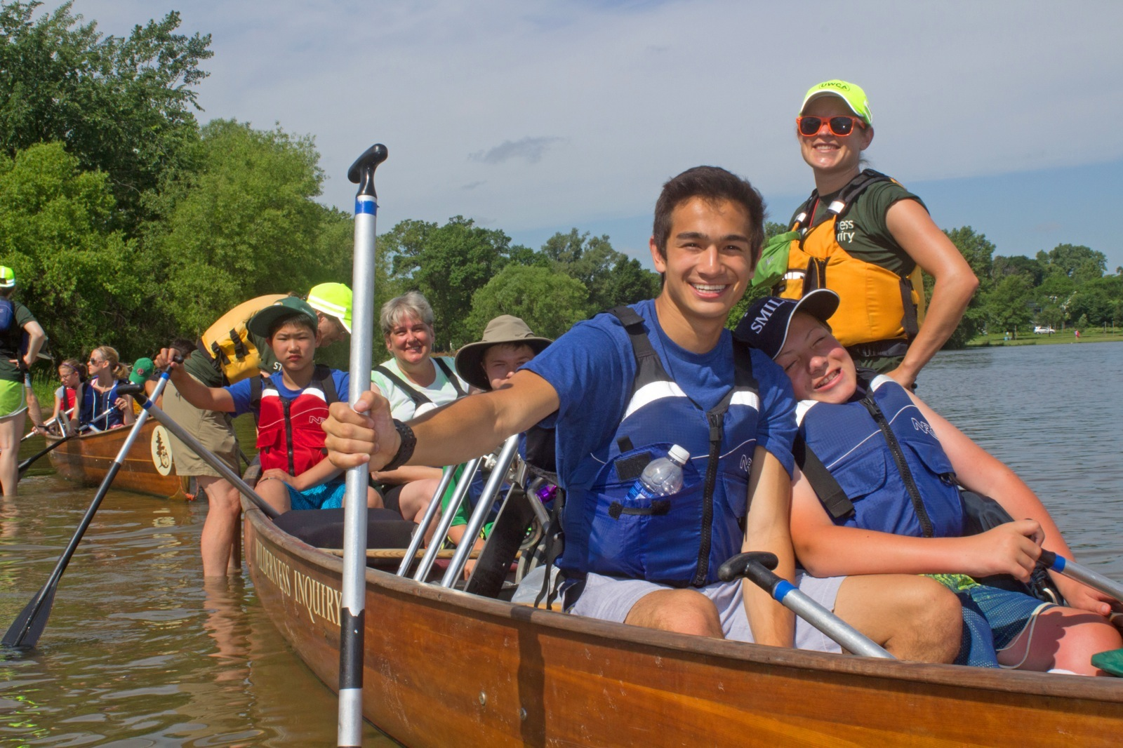 Participants get ready to take off down the river in their canoe at Minneapolis Chain of Lakes.