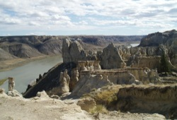 A view from atop the canyon shows interesting rock formations and the calm Missouri River below.