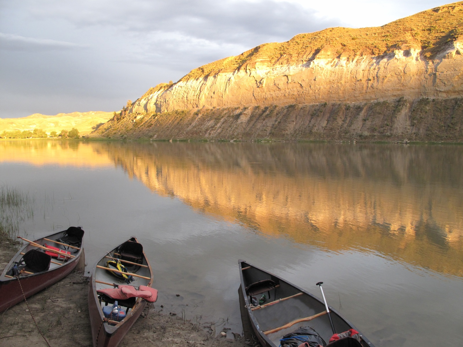 The calm waters of the Missouri reflect the White Cliffs at sunset near Judith Landing.