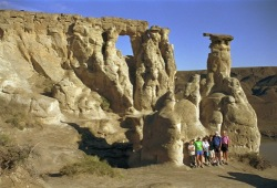 A family poses in front of a huge rock formation called Hole-in-the-Wall along the banks of the Missouri River.