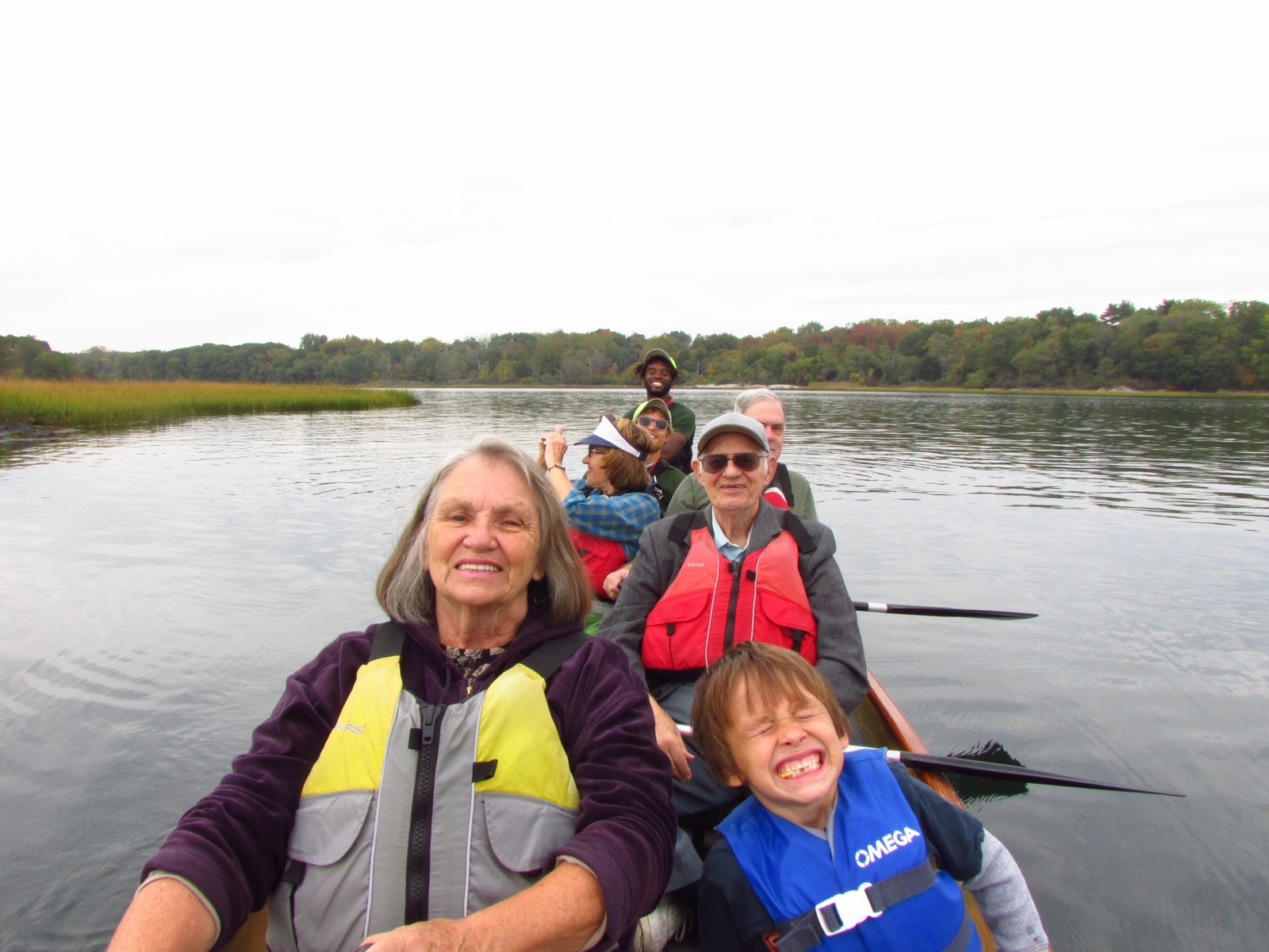 a group of 7 paddle their Voyageur canoe in Pelham Bay Park