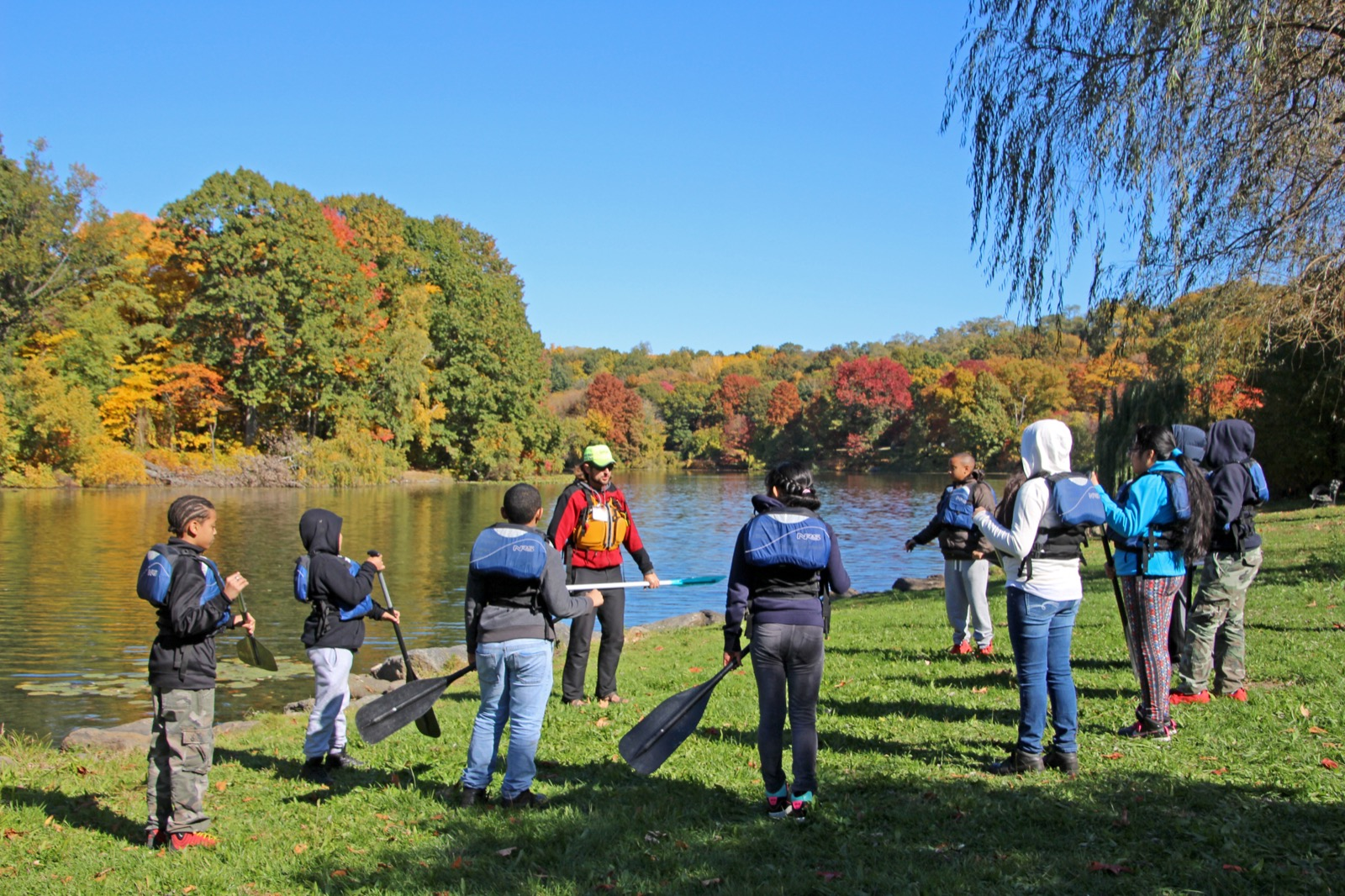 Students learn the fundamentals of paddling on land