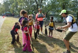 group of young students learn how to use paddles on land