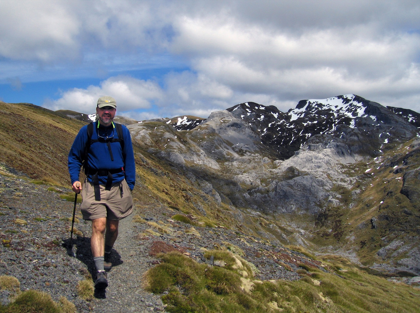 A participant treks along a path to Mt. Arthur to take in the amazing view of the mountains behind him.
