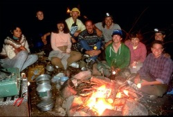 The participants gather around a campfire for dinner on Wasp Lake in the White Otter Wilderness.