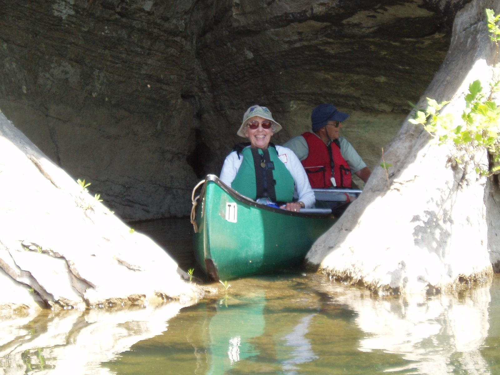 Two participants in a canoe exit a limestone cave near the Mt. Hershey campsite.