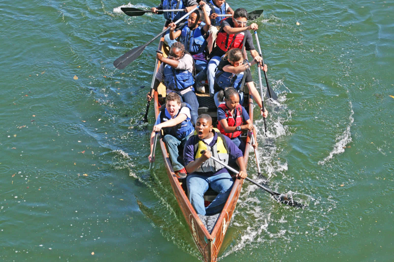 action shot of canoemobile participants paddling the canoe