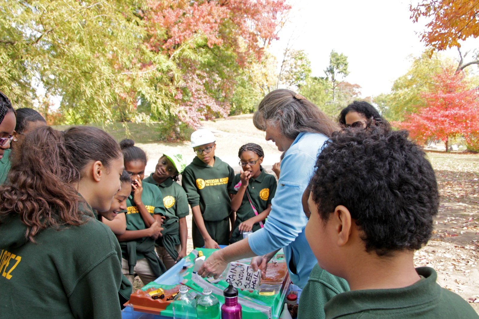 a group of youth learn about water quality in the fall
