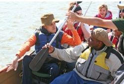 an integrated canoe trip gets ready to paddle on the water