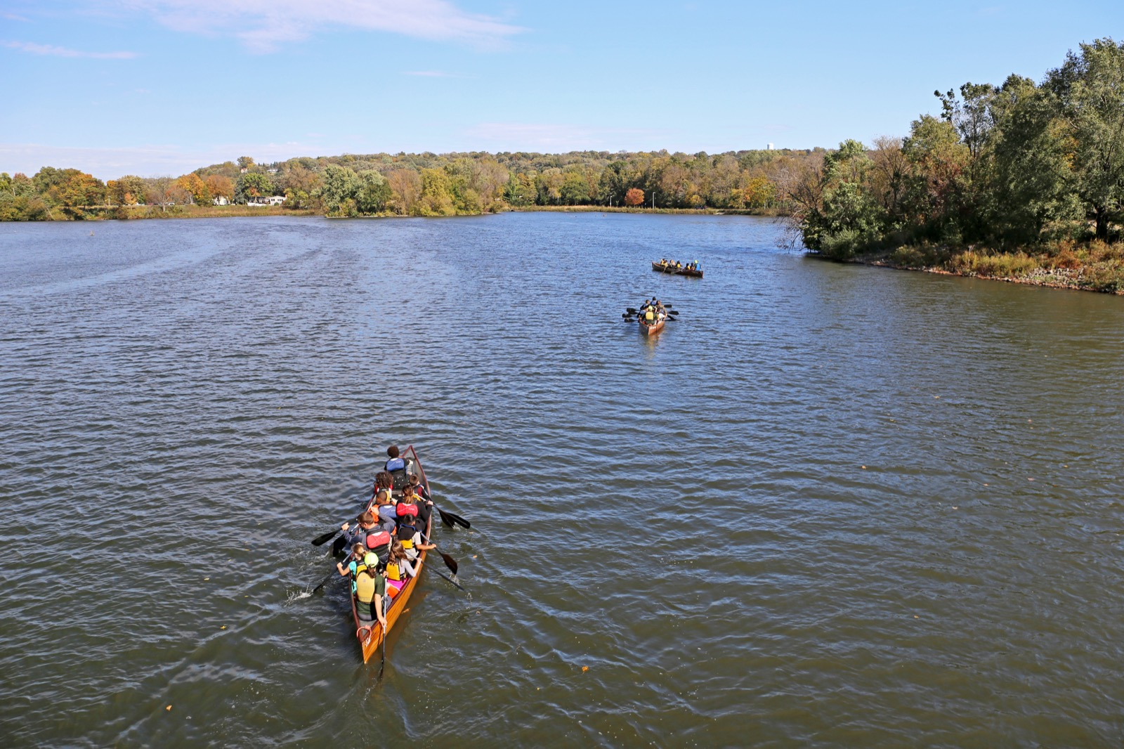 Voyageur canoes on the water