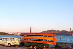 a photo of the canoemoble van with the canoes across from the Golden Gate Bridge