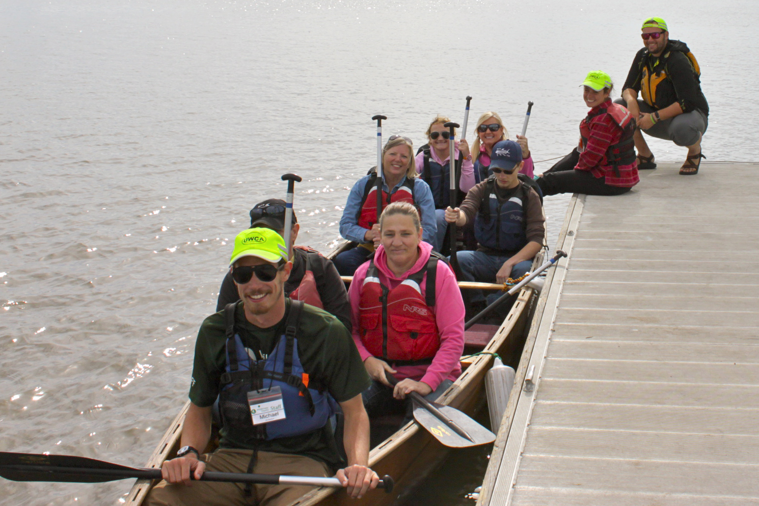 Participants are ready to paddle the canoe away from the dock on the Savannah River