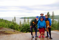 Four participants pose at an overlook near McGreevy Harbor in the Slate Islands.