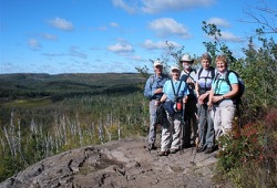 Participants take in the view from a rocky ledge on the Superior Hiking Trail.