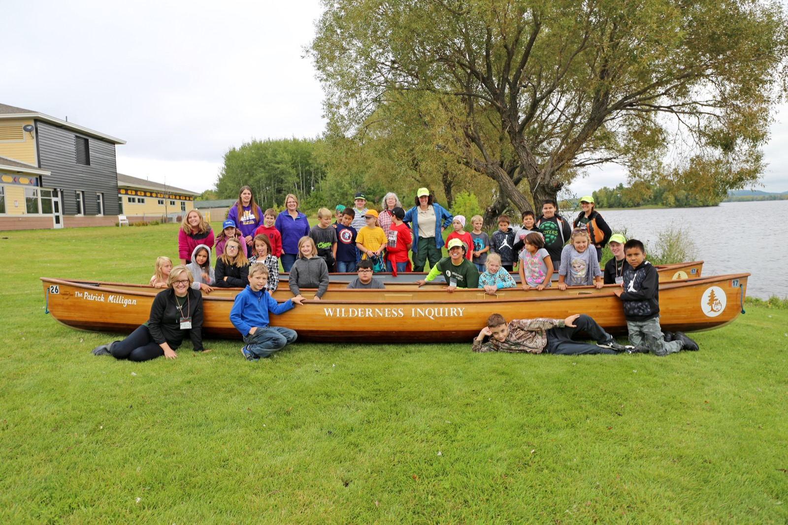 Students from Tower-Soudan schools pose with a canoe.