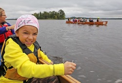 A student from Tower paddles a Voyaguer canoe.
