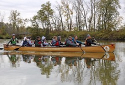 Students from Troy, Ohio paddle a Voyageur canoe