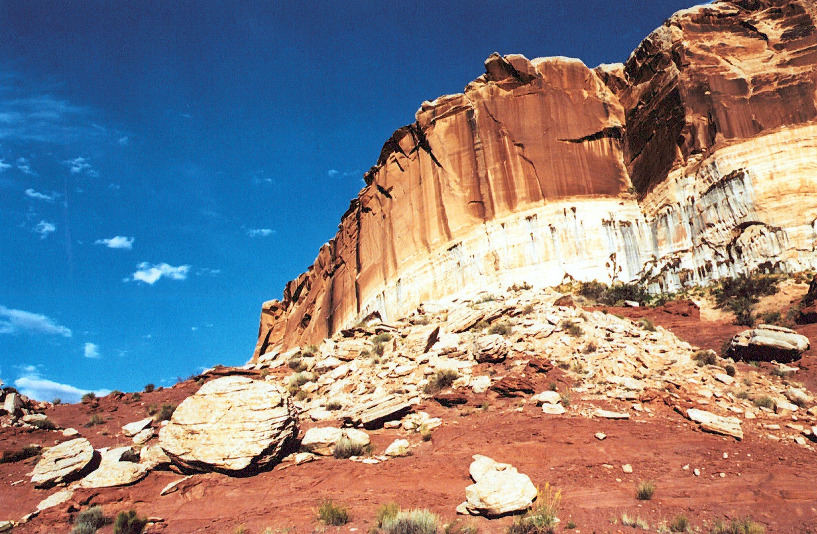 Large red rock formations and blue sky on the Green River.